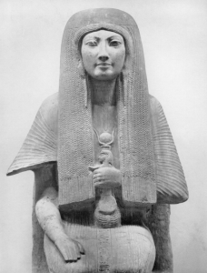 Merit, wife of Egyptian official Maya, wearing ceremonial attire of temple singer and an amulet.